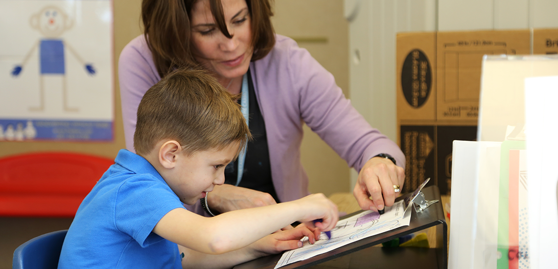 Carruth Center Occupational Therapist works with boy on handwriting skills